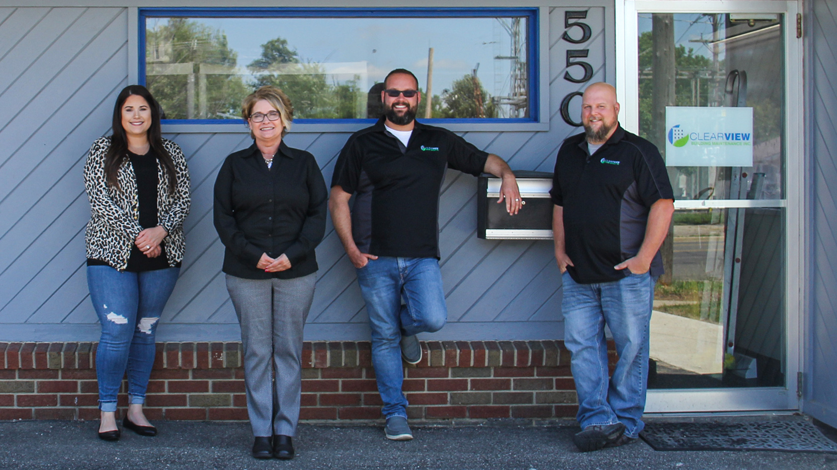 Owner and President Dena Craine and staff outside Clearview office
