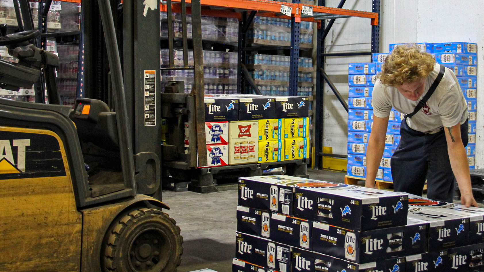 Employee works in a beer distributor warehouse