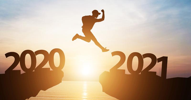 Man jumping mountain into 2021