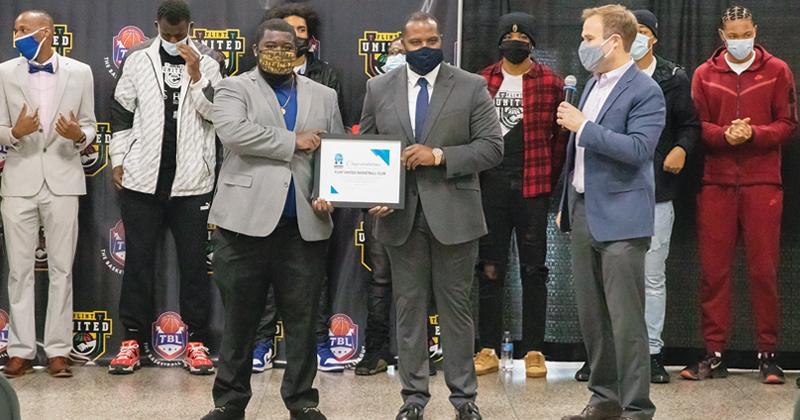 Flint United Basketball ribbon cutting