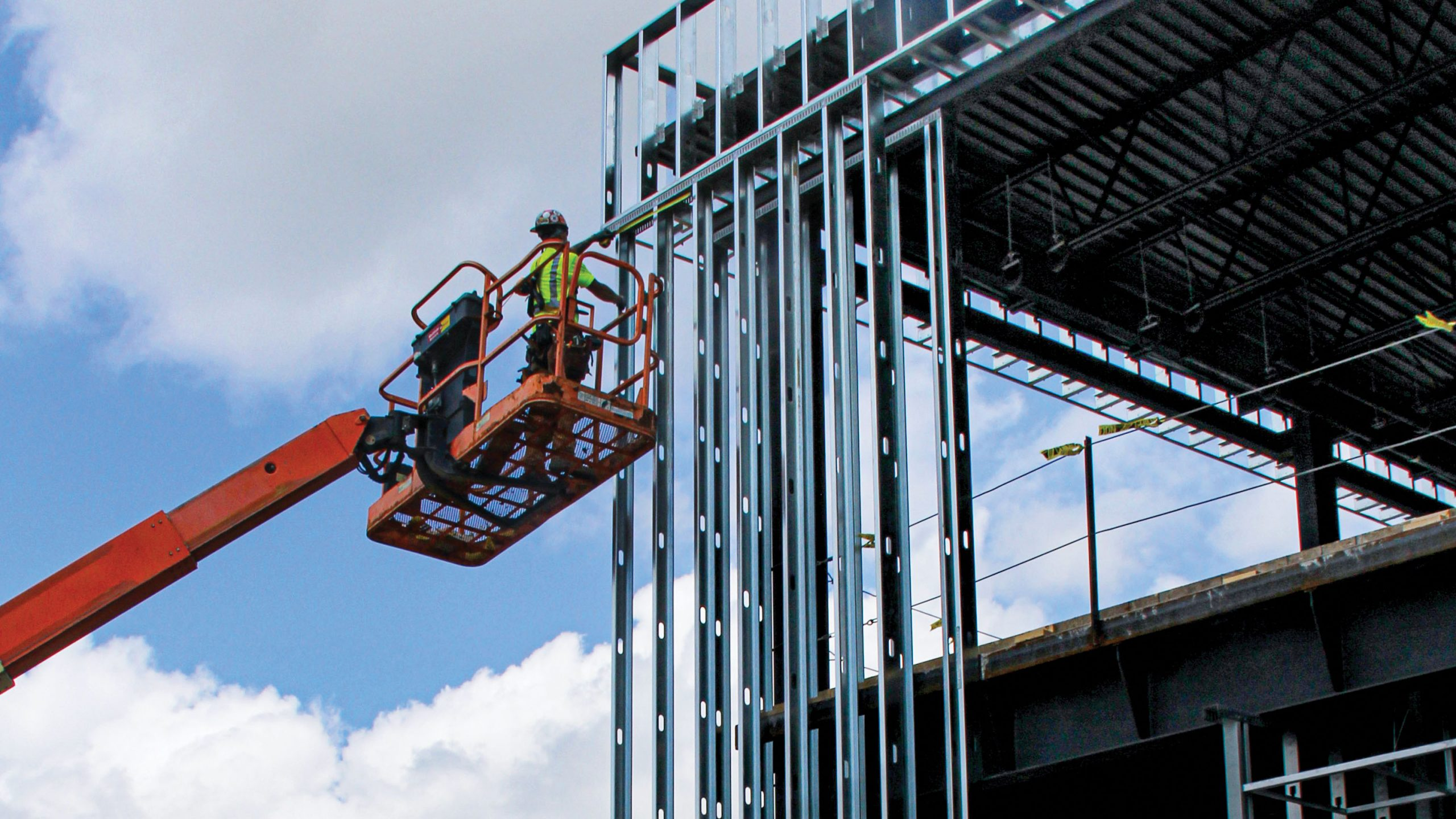 Skilled tradesmen work on the construction site of ELGA Credit Union's new headquarters