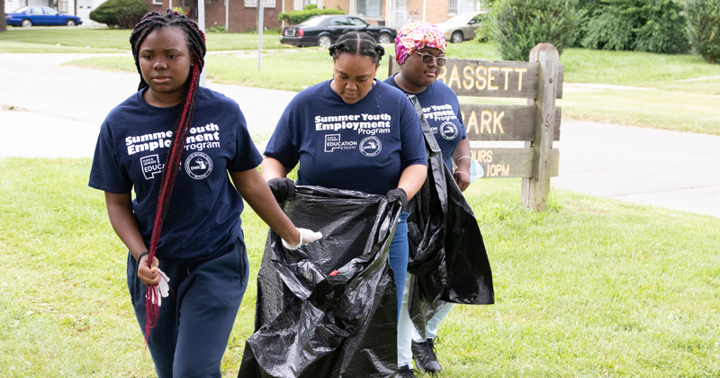 students participate in a park clean-up